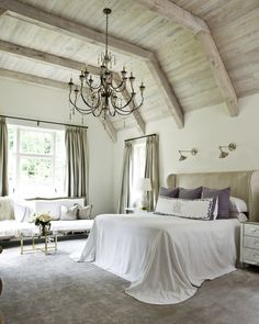 "Atlanta-based Suzanna Kasler emphasizes the notion of ""collecting"" over ""decorating."" We love how she added drama to this elegant bedroom with an oversized chandelier."