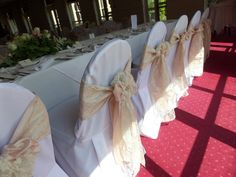Bagden Hall - Orchard Suite - Lana & Anthony's wedding reception. Linen chair covers with blush taffeta & lace sash. www.uniqueweddingflowers.co.uk