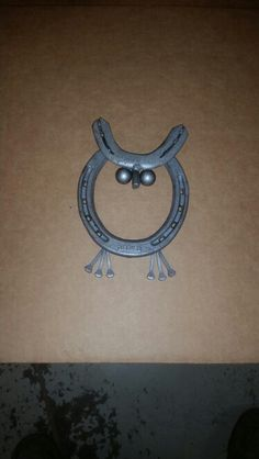 Owl / horse shoes