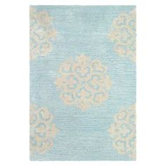 New Zealand wool rug with a medallion motif in turquoise and yellow. Hand-tufted in India. Product: RugConstruction Material: WoolColor: Turquoise  and yellowFeatures:  Made in IndiaHand-tufted Note: Please be aware that actual colors may vary from those shown on your screen. Accent rugs may also not show the entire pattern that the corresponding area rugs have.Cleaning and Care: Professional cleaning recommended