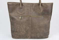 http://www.everhandmade.com/collections/tote-bags/products/handmade-modern-gray-vintage-leather-minimalist-handbag-tote-shopper-bag-for-women