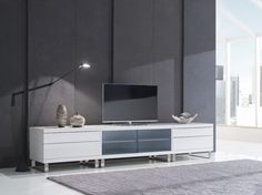 Quattro 480+4120SD+480. Supported on sturdy rounded feet of brushed stainless steel, these units are slightly raised and maintain a sleek, low profile for optimal viewing.