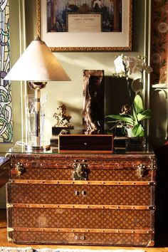 Antique Louis Vuitton steamer trunk and rosewood (?) LV inlaid wooden box.  Both at the Vuitton family home in Asnières, just outside Paris.
