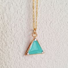 Gold triangle necklace filled with turquoise green resin. I filled the gold triangle tray with hand colored resin, put three silver triangles and covered them with colorless transparent resin. Please choose your favorite chain length from 5 options. This item is made to order. Please see Shipping & Policies section for the days to ship and other important information. Your jewelry will come to you in a box decorated with washi tape that is ready for casual gift giving. See my About page...