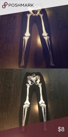 """Skelton Leggings Front to back skeleton leggings used at Halloween. They end short (I am 5'4"""") but work great and look cute once a pair of heels are on. Pair with a cute Halloween shirt and you have a relaxing outfit for a party! The season is near people!!  ❤️ (worn once!!!) would fit youth size as well Pants Leggings"""
