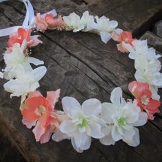 Brand new flower crown design listed in the shop this morning. Loving the Coral and White . These flowers are divine! Accented with baby's breathe and small dried white flowers. This crown will fit both adult or child so anyone can wear this beauty! Find it at  Dieselboutique.etsy. com  #bohobride #flowergirl #coachella #lanadelrey #festival  #Festivalfashion #flowercrowns #boho #bohemian #gypsy #hippie #romantic #babysbreath #flowercrown #pinkwedding #bohochic #hippiespirits #coralwedding…