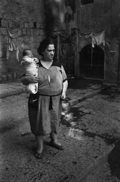 by David Seymour A Napolitan mama summons the rest of her flock whilst the youngest rests in her arm, Naples, 1948.