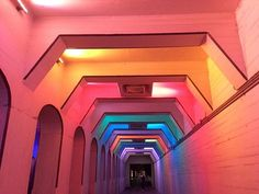 """How do you make a dark underpass less intimidating? Light it up like a rainbow. 'LightRails,' a.k.a. the Color Tunnel, is an installation underneath the old 18th Street viaduct near Railroad Park in Birmingham, AL. The piece, designed by San Antonio artist Bill FitzGibbons, comprises thousands of colorful LED lights programmable in more than 16 million color combinations. Public works FTW!"" —#CNTtakeover by @ashleahalpern of @cartogramme #TravelerInBirmingham #TravelerInAlabama…"