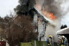 Firefighters battle a blaze on Fitzgerald Street Monday afternoon. #tbay