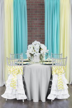 Yellow, gray, turquoise chevron baby shower tablescape