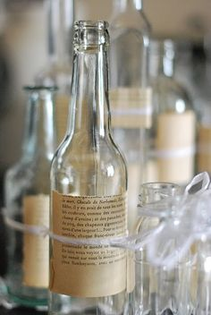 Cute decorating idea with bottles. Your favorite book page, or favorite scripture/quote written on it. SO STINKIN' CUTE!