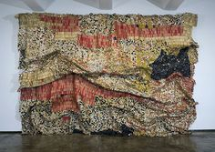 The glittering multi-colored murals by El Anatsui may look like they are made of precious metals, but take a closer look and you'll recognize that the mosaic bits are recycled bottle caps! Working on a massive scale, the Nigeria-based artist has covered building facades with his rich tapestries made from disused bottle caps, remnant metals and wire. Anatsui sources bottle caps and seals from alcoholic drinks, many which he finds in garbage dumps near Nigerian distilleries.