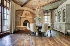 Love those floors!...& fireplace being surrounded by brick. Love brick ceiling too.