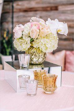floral centerpieces and votives @weddingchicks
