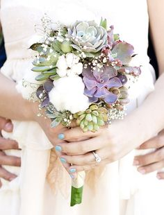 Wedding bouquet of succulents, baby's breath and cotton.  So different and beautiful!     Photo by LMO Studio www.facebook.com/lmostudio