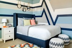 Boys bedroom - interesting stripe detail on the wall! So unique!