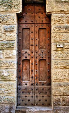 Wood door in Volterra, Tuscany, Italy