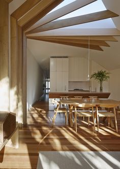 A tall half open ceilling letting the nature light come in will make this dining room look alive.
