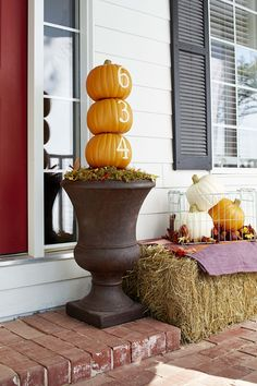 Stack faux pumpkins carved with your house numbers at your entry for a friendly fall welcome.