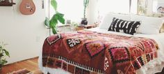 These Bohemian Bedrooms Will Make You Want to RedecorateASAP | I love the textures and the furry throws nStyleCaster
