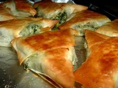 Greek Spinach Triangles - i think the spinach and feta spanikopita filling would be good baked in croissants, too, if you didn't want to mess with the phyllo dough.