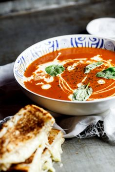 Hungry: Eleven Comforting Dinners  Roast tomato soup with the ultimate Toasted Cheese sandwich (via Simply Delicious)