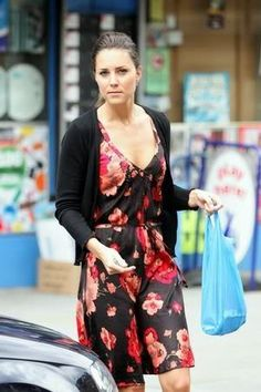 Kate Middleton casual street style from before her marriage floral dress and black sweater