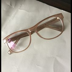 Stunning Nude Eye glasses  This is a pair of crystal nude glasses. Very stylish. Great comfort on nose, very light. Perfect for any prescription. Very girlie! Size 52-18-145. Perfect if you have a flat nose bridge. These glasses will stay on your face without really slipping down. Envision Accessories Glasses