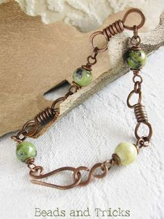 wrapped wire links with short supply beads