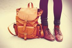 brown book bag and boots.