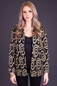 Killer open front 80s style cardigan in black and gold. This metallic knit cardigan is covered in one of the coolest prints we've seen in a long time - abstract twisted snakes! Sweater has an open front with two button holes at the collar, slightly sheer. Excellent condition. Marked Size 14P, fits like a one size fits most. Double bust, waist, and hip for exact measurements. Fits model as shown.