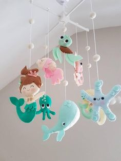 Early mobiles did not necessarily move, as do most crib mobiles today. The modern crib mobile is… Mermaid Nursery Theme, Sea Nursery, Mermaid Bedroom, Nursery Themes, Girl Nursery, Ocean Themed Nursery, Cot Mobile, Baby Crib Mobile, Baby Mermaid
