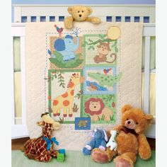 The Savannah Baby Quilt Stamped Cross Stitch Kit is a jungle & safari themed design from the Dimensions Baby Hugs collection.  Baby quilt kit includes a pre-quilted, pre-finished stamped muslin/polyester crib cover, presorted cotton thread, needle, and instructions.  The cross stitch design is pre-printed on the quilt in wash-away ink.