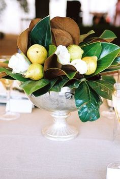 Centerpiece option 2 inspiration: this is the ratio of fruit to leaves and flowers, but brighter colors!