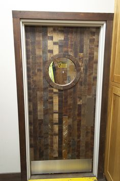 Swing door made from an up-cycled beech wood shipping container.
