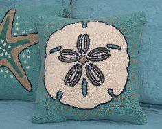 Our Sanddollar shows upbeautifully on gorgeous deep aqua. Wool Hook pillow…