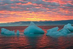Ice chunks float in the Arctic Ocean as the sun sets near Barrow, Alaska. The Arctic is a thermostat against overheating and a barometer of change, but now its own protective ozone layer that keeps out damaging ultraviolet radiation has thinned to record levels, the U.N. weather agency has said.