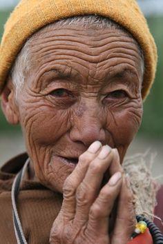 Woman in the neighbourhood of Pema