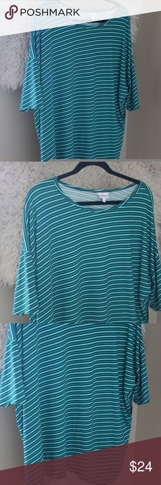 "Lularoe Irma Tunic Diagonal Stripes High Low New With Tags Lularoe Irma Tunic.  Size extra large.  Short sleeves.  Diagonal stripes in blue, green, and teal colors.  96% polyester, 4% spandex.  Machine wash.  No flaws noted.  Measures 28.5"" pit to pit, 32"" shoulder to back hem, 28"" shoulder to front hem approximately. LuLaRoe Tops Tunics"