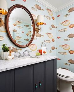 Talk about bold wall paper. This fish themed wall paper really compliments the smooth wave inspired design of Iyla widespread faucet. Fish Bathroom, Bathroom Kids, Bathroom Faucets, Small Bathroom, Coastal Wallpaper, Bold Wallpaper, Fish Wallpaper, Bathroom Wallpaper Fish, Print Wallpaper
