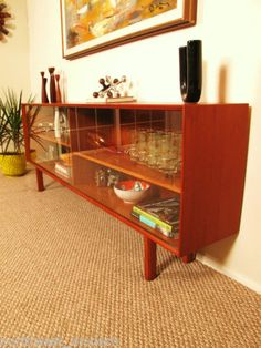 This is exactly what we need. (danish credenza in teak with glass doors)