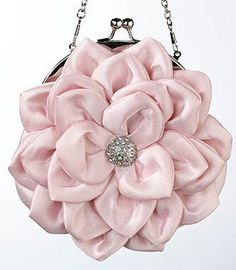 This pink satin purse is perfect for carrying your wedding day essentials. It is…