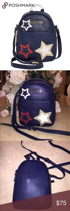 """NEW TOMMY HILFIGER CROSSBODY BAG New Tommy Hilfiger mini backpack crossbody bag..all leather in navy blue..3 stars in front in leather..gold zipper..pocket in front..dimensions: 7.5"""" x 6.5"""" x 3.5""""..brand new with tags..refer to pics.. Tommy Hilfiger Bags Crossbody Bags"""