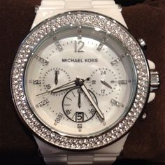 MK white ceramic watch:) this is the one I want