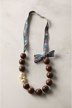 Anthro Knockoff – Into the Woods Necklace  Trying her suggestion of black beads and satin ribbon with a cameo