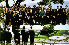 Jackie is laid to rest next to JFK in Arlington Cemetery on May 23, 1994.