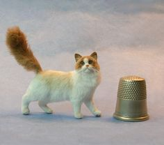 Ragdoll cat with poseable tail by Kerri Pajutee in 1:12 dolls house scale. - Photo Courtesy Kerri Pajutee Copyright 2008 Used With Permission