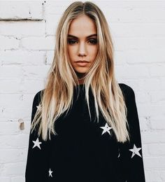 Cute black sweater with white stars.