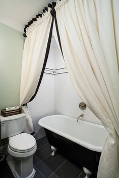 Clawfoot tub + shower, subway tile, reclaimed wood floors, small ...