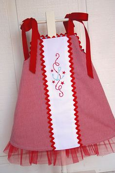 This side of the dress I decided to make it with a cute sailing theme. The embroidery is from www.emblibrary.com I used red check and white pique, both from Fabric Finders.